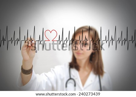 Female doctor drawing a heartbeat. Medical concept. - stock photo