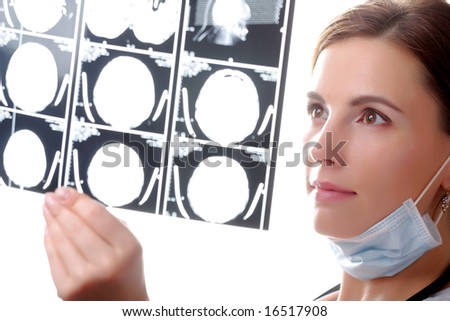 Female doctor examining a brain cat scan - stock photo
