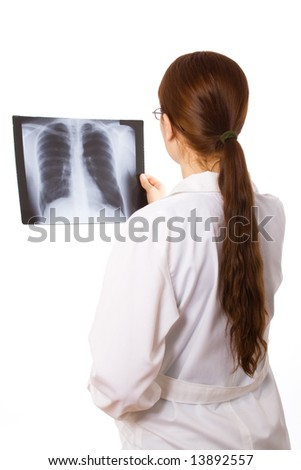 Female doctor examining a thorax x ray - stock photo