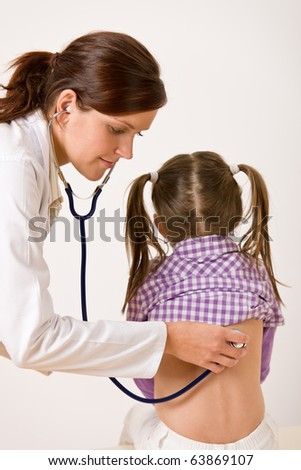 Female doctor examining child with stethoscope at medical office - stock photo