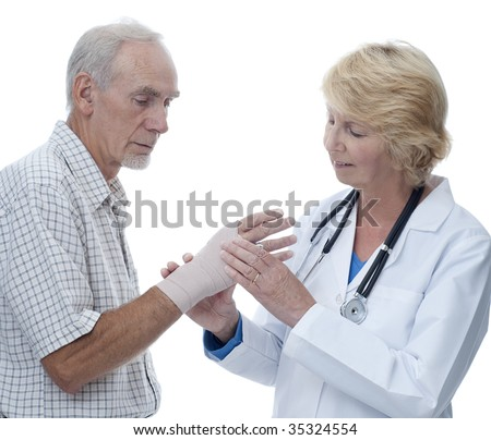Female doctor examining senior's bandaged hand