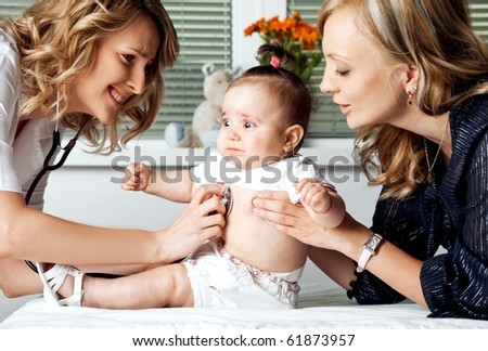 Female doctor examining with stethoscope little scared baby girl being held by mother - stock photo