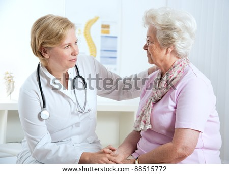 female doctor explaining diagnosis to her female patient - stock photo