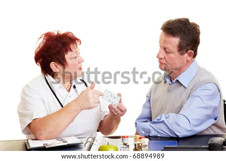 Female doctor explaining side effects of medication to a patient - stock photo