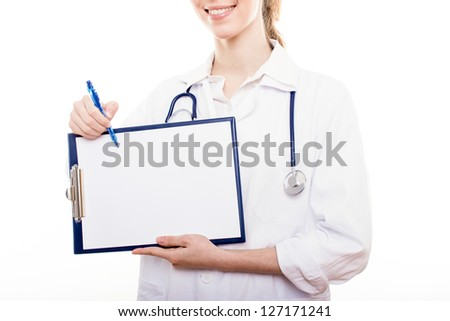Female doctor filling out medical document.