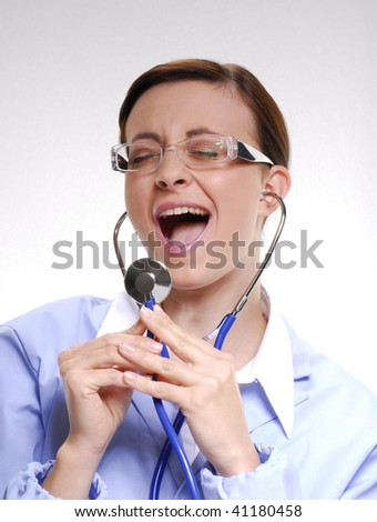 Female doctor holding a stethoscope. - stock photo