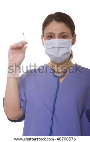 Female doctor holding a syringe - stock photo