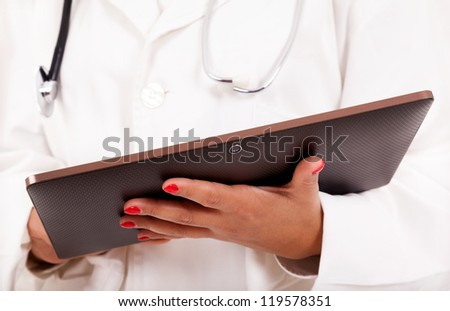 Female doctor holding a tablet computer, isolated over white background. - stock photo