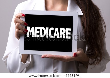 Female doctor holding a tablet with the text: Medicare