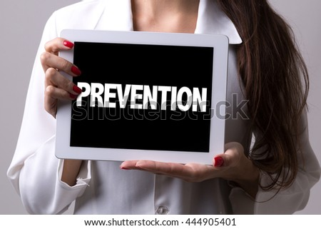 Female doctor holding a tablet with the text: Prevention