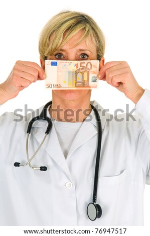 female doctor holding banknotes - stock photo