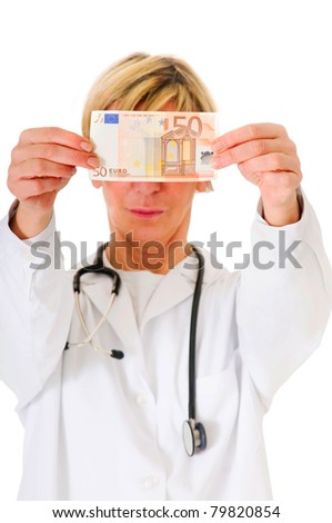female doctor holding banknotes cut out isolated on white background - stock photo