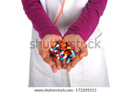 Female doctor holding colourful capsules. - stock photo