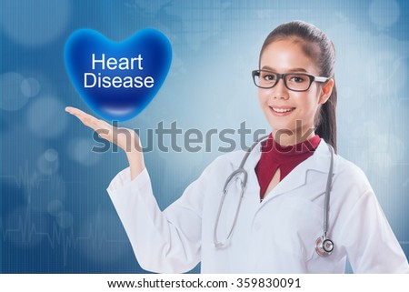 Female doctor holding heart with Heart disease sign on medical background. - stock photo