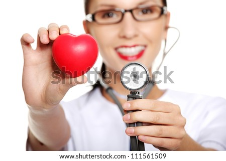 Female doctor holding red heart in hand. Isolated on white background