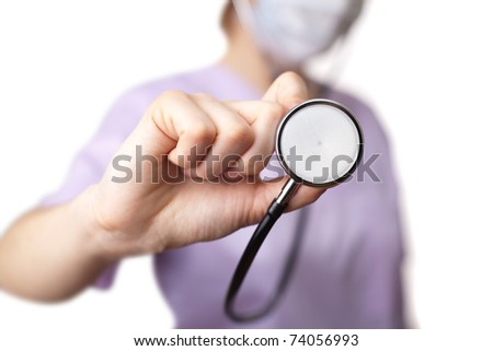 Female doctor holding stethoscope pointed toward camera. selective focus - stock photo