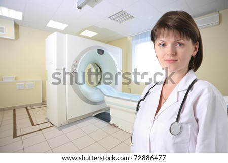 Female doctor in CT Scanner room - stock photo