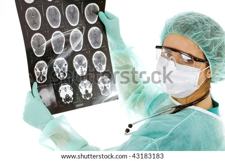 female doctor in medical mask and protective glasses  looking at tomography brain - stock photo