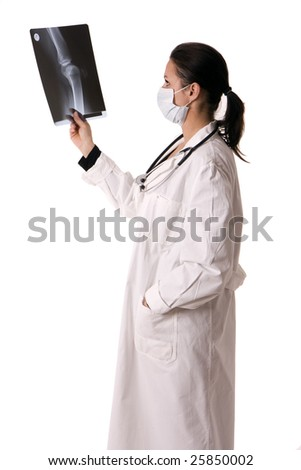 female doctor in medical mask looking at x-ray, leg