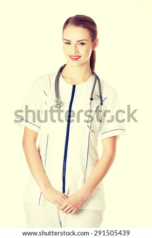 Female doctor in uniform wearing stethoscope - stock photo