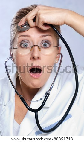 Female doctor listening her mind with stethoscope
