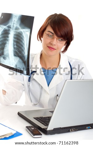 Female doctor looking at a lungs or torso x-ray image - stock photo