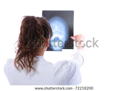 Female doctor looking at an x-ray isolated on white
