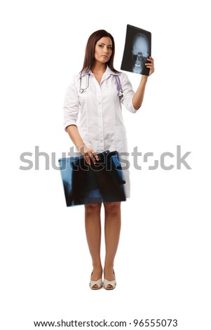 Female doctor looking at an x-ray over white background - stock photo
