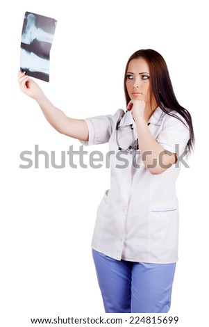 female doctor looking at the x-ray image.  Isolated on white background - stock photo