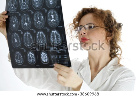 female doctor looking at tomography brain - stock photo