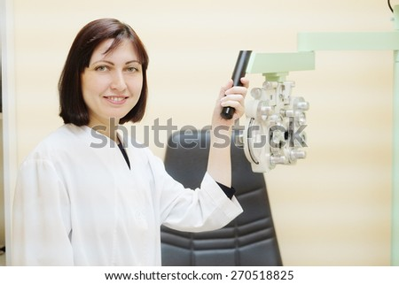 Female doctor optometrist in ophthalmology clinic  - stock photo