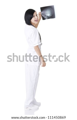 Female doctor or nurse looking at radiography photo - stock photo