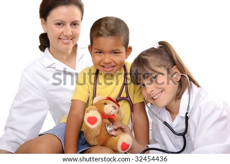 female doctor playing with the children - stock photo