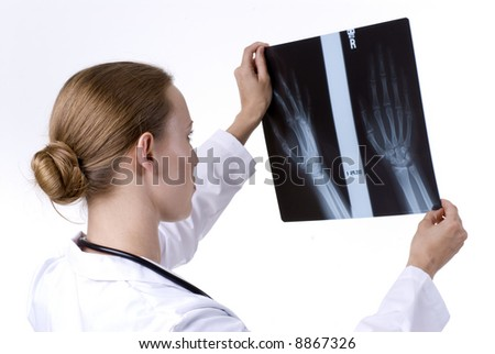 Female Doctor Reading an X-Ray - stock photo