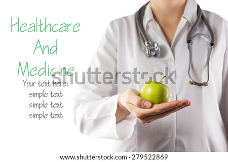 Female doctor's hand holding green apple isolated on white background. Concept of Healthcare And Medicine. Copy space - stock photo