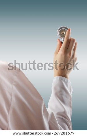 Female doctor's hand holding stethoscope on blurred background. Concept of Healthcare And Medicine. Copy space - stock photo