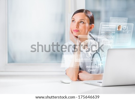 Female doctor scanning brain of patient with help of modern technology - stock photo