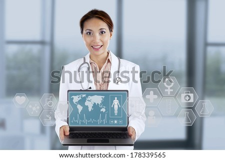 Female doctor showing medical interface with help of modern technology - stock photo