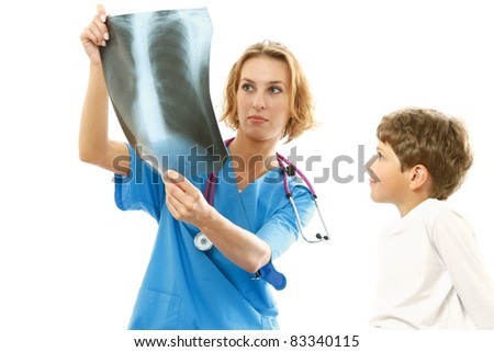 female doctor showing x-ray to a child - stock photo