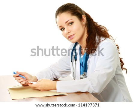 Female doctor sitting on the desk, isolated on white background