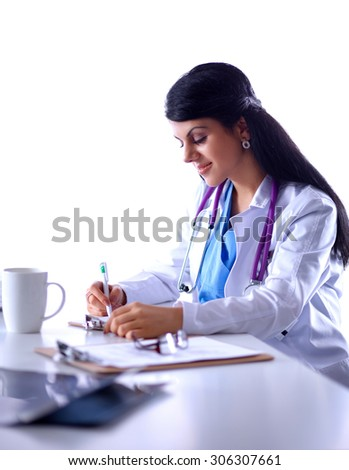 Female doctor sitting on the desk with paper  and working  - stock photo
