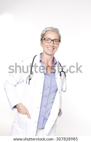 Female doctor smiling - stock photo