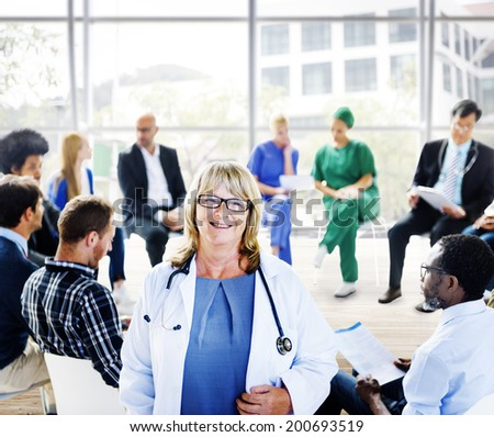 Female Doctor Standing in Front of a Support Group - stock photo