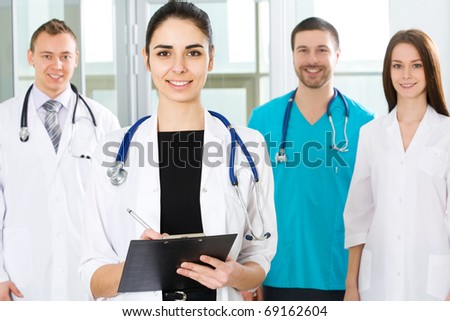 Female doctor standing with colleagues in a hospital