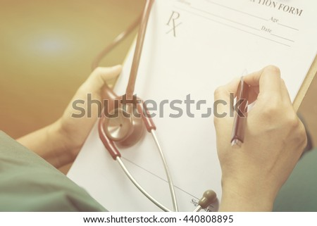female doctor,surgeon,nurse,pharmacy with stethoscope on hospital holding clipboard,writing a prescription,Medical Exam,Healthcare and medical concept,test results,vintage color,selective focus - stock photo