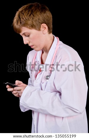Female doctor texting on a cell phone