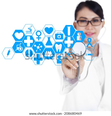 Female doctor touching medical interface on modern technology - stock photo
