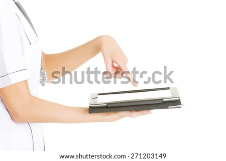 Female doctor using a tablet. - stock photo