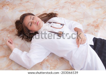 Female doctor very tired from her work . - stock photo