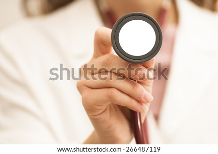 Female doctor wearing a stethoscope around his neck and in hand - stock photo